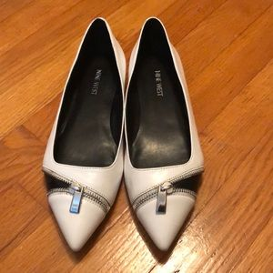 White Nine West flats with zipper
